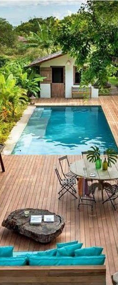 residential pool with wooden deck